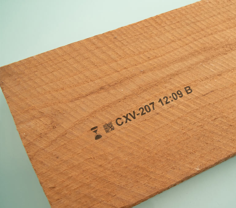 lumber with graphic, QR code, part number, and time