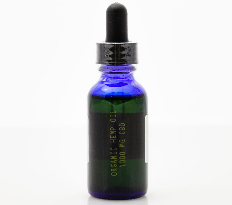 blue tincture bottle with yellow ink imprint of name and mg label