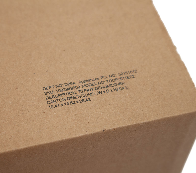 cardboard box with department, SKU, description, and dimensions