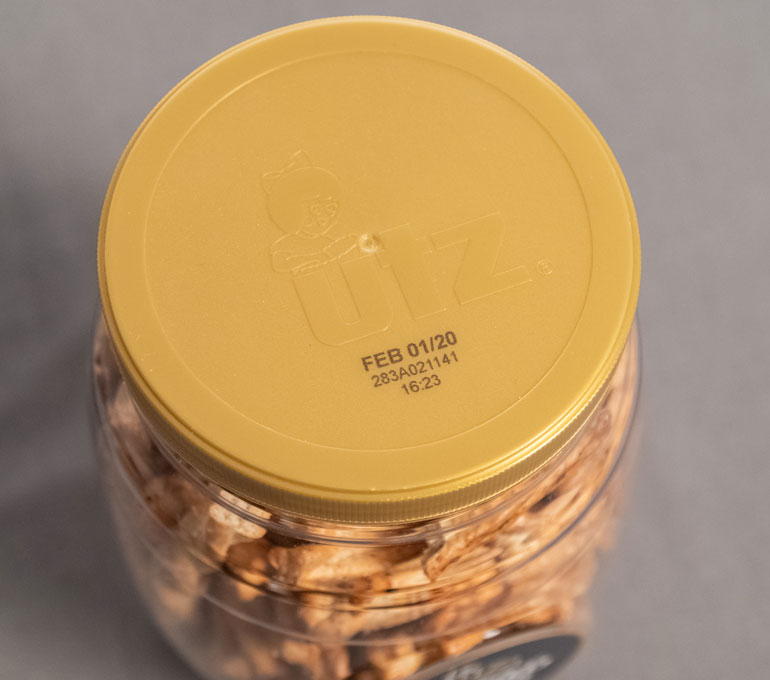 plastic jar lid with date and serial code