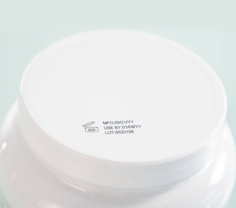 plastic container with date and lot number on lid