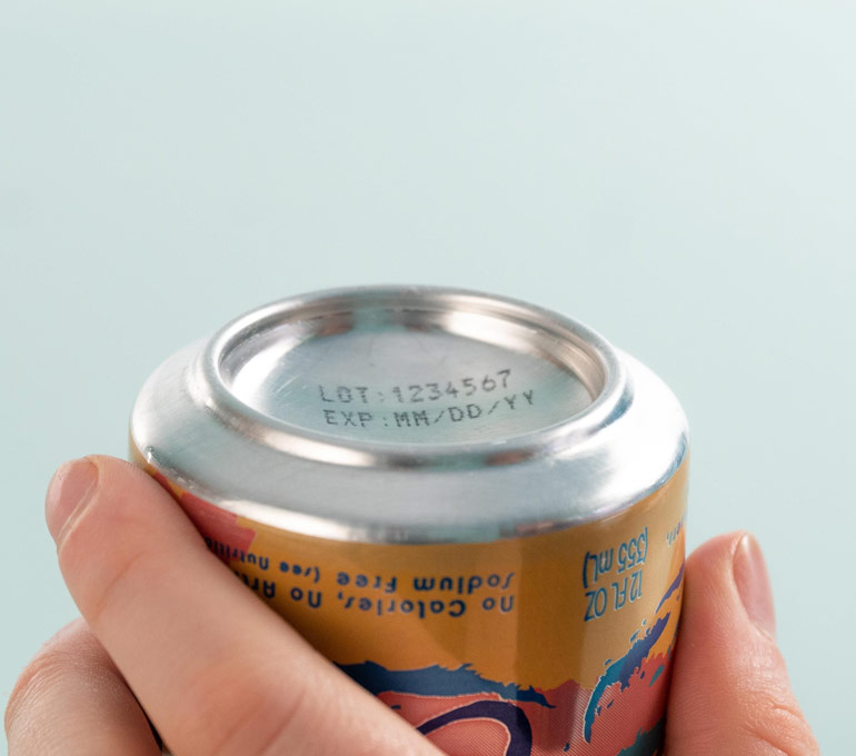 Metal can with lot number and expiration date