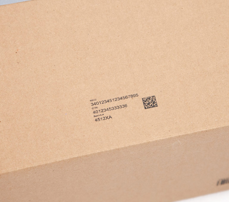 cardboard box with code, serial, and batch number