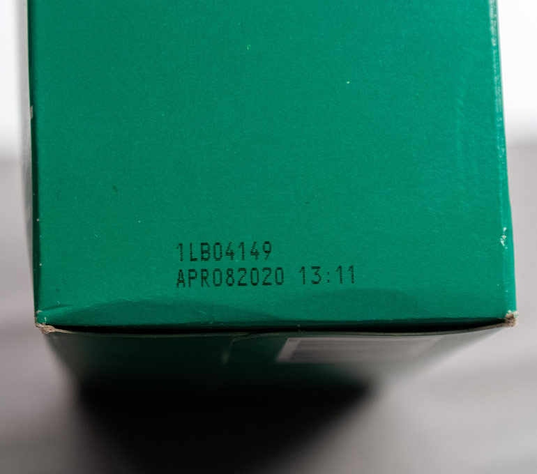 Green packaging with weight and date