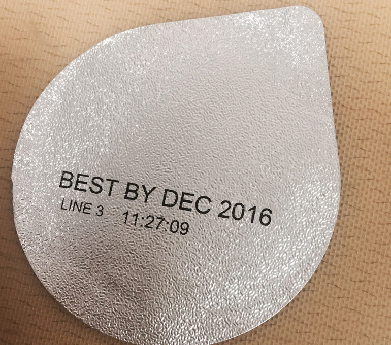 Metal tab with best by date and time