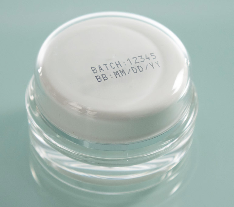 plastic jar with batch number and best by date