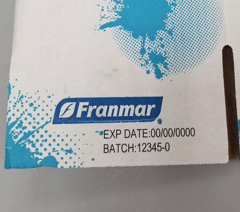 White and blue box with expiration date and batch number